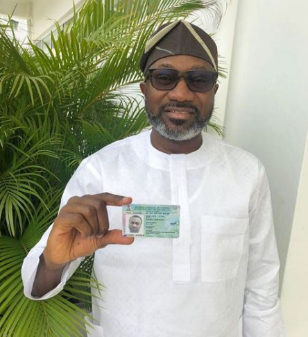 Billionaire Femi Otedola Shows His PVC, Ready To Vote