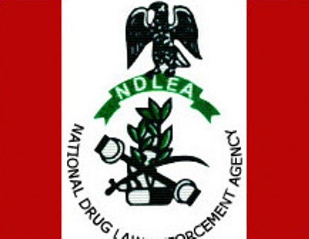 Families of late NDLEA officers take away corpses for burial