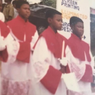 """My Mother Wanted Me To Be A Reverend Father"" - John Dumelo Shares Throwback Photo"