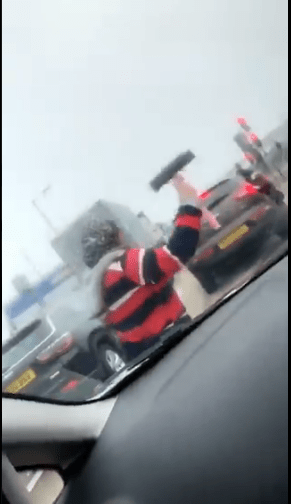Nigerians Surprised As They See Female Traffic Windscreen Cleaners Abroad
