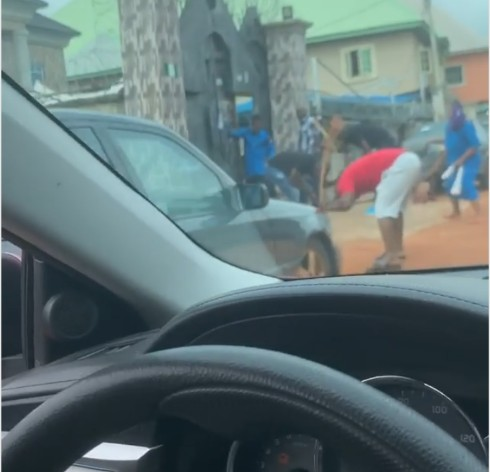 Church members flogging the devil
