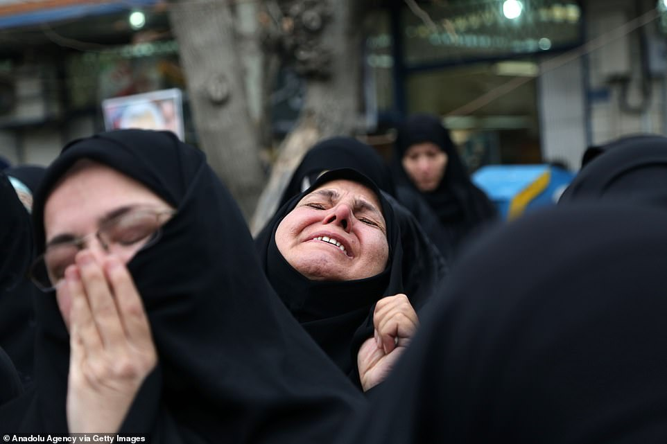 Iranian women crying after death of leader of Iran's Quds force, Qassem Soleimani