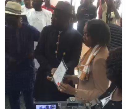 Douye Diri and his deputy being presented certificates of return by INEC