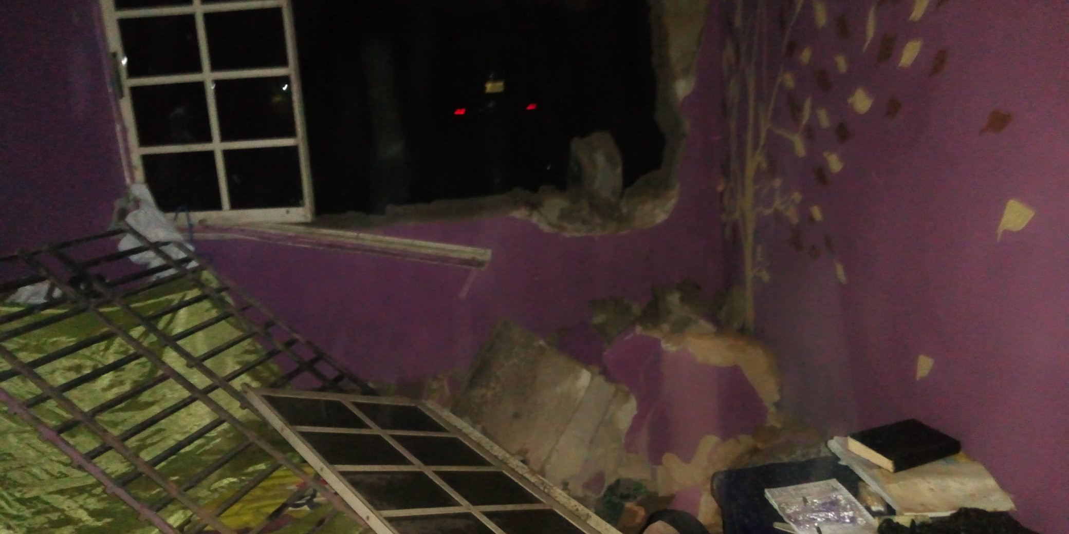 Woman escapes unharmed after heavy wind blew off her windows and wall at night