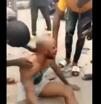 The man rolled on the floor before stripping himself