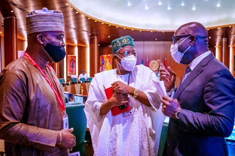 Obaseki with Lai Mohammed and another member of Buharis cabinet.