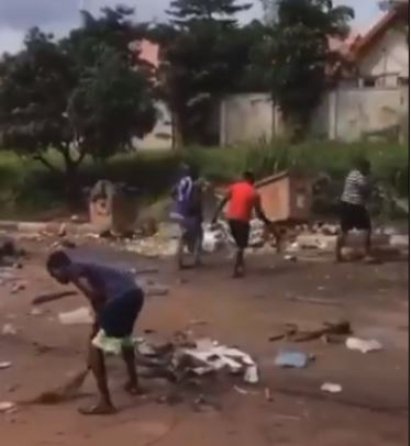 Enugu Youths Seen Cleaning Up Their Community After Hoodlums Left It In A Mess (Video)