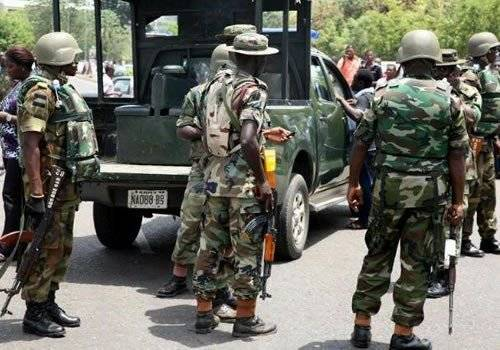 Nigerian Soldiers Brutalize Medical Doctor, Order Him To Bathe Inside Gutter In Delta State