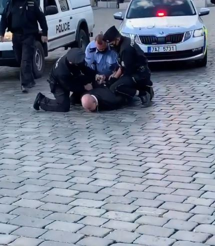 See The Moment A Thug Was Arrested As He Tried To Disrupt #EndSARS Protest In Czech Republic (Video)