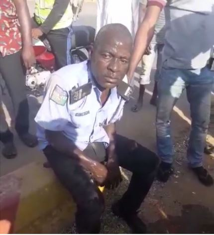 Drama As People Seize Gun From A Drunk Policeman, Pour Water On Him To Help Him Revive (Video)
