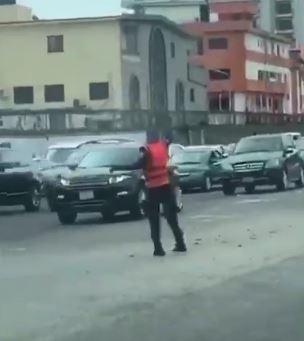 Police officer filmed dancing leg work while controlling traffic