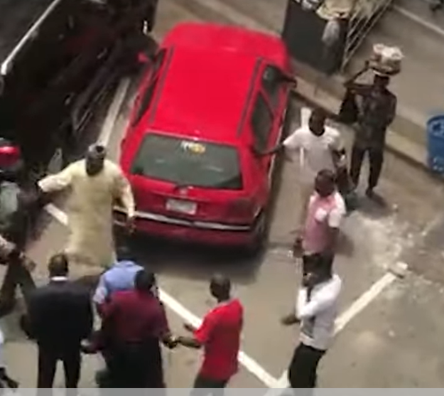 Code of Conduct Tribunal chairman tackles security guard to ground, on-lookers fight back
