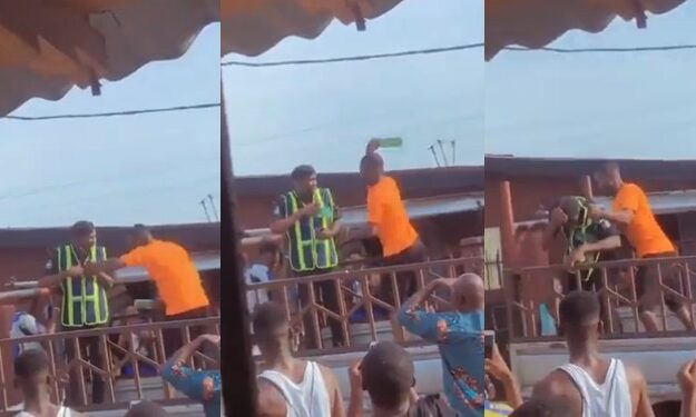 Angry Driver Breaks Bottle On Policeman's Head For Trying To Impound His Car In Lagos [Video]