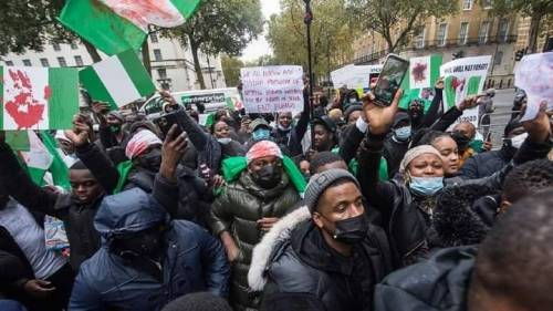 Breaking: Nigerians storm Buhari's residence in UK, demand his return home