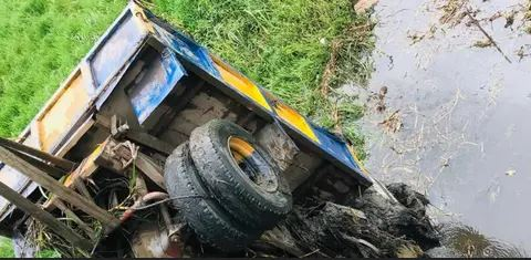 Motor Boy Narrowly Escapes Death In Ogun As Truck Plunges Into A River