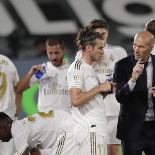 Real Madrid stay in title hunt with win at Granada