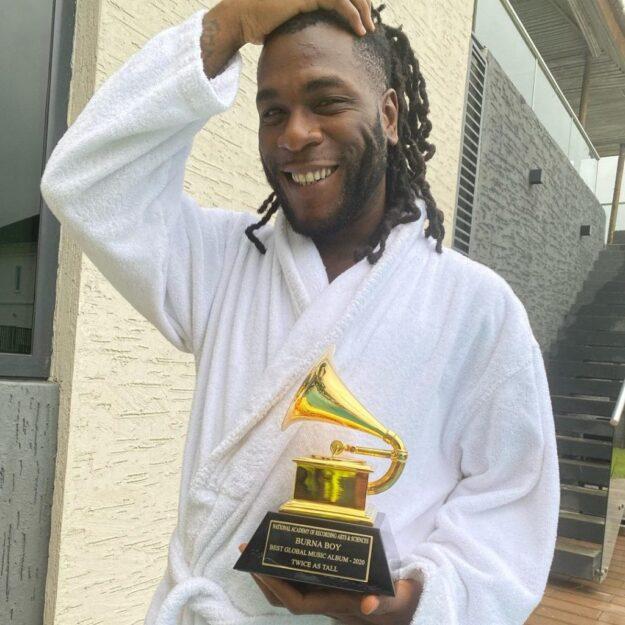 True Grammy Award winner, Burna Boy receives his Grammy plaque in Lagos