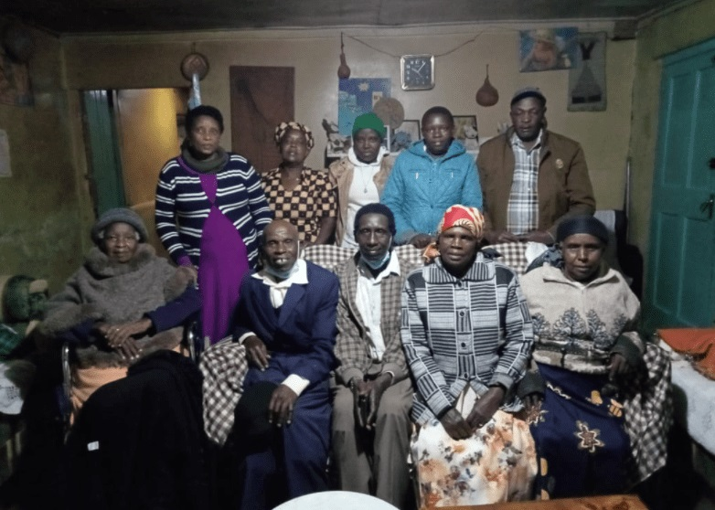 James Mwaura ( in blue suit) is reunited with his family members
