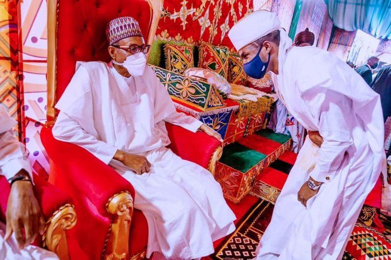 President Muhammadu Buhari takes salute from his son, Yusuf