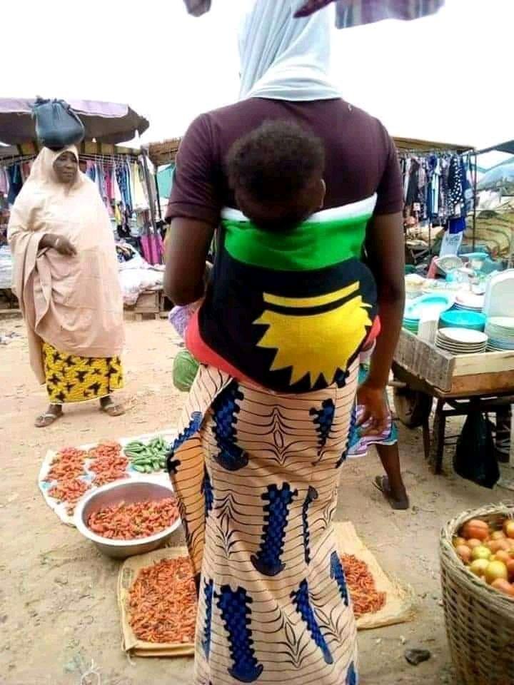 Chiwetalu Agu: Nigerians Reacts Arewa Woman Straps Her Baby With Biafra Cloth